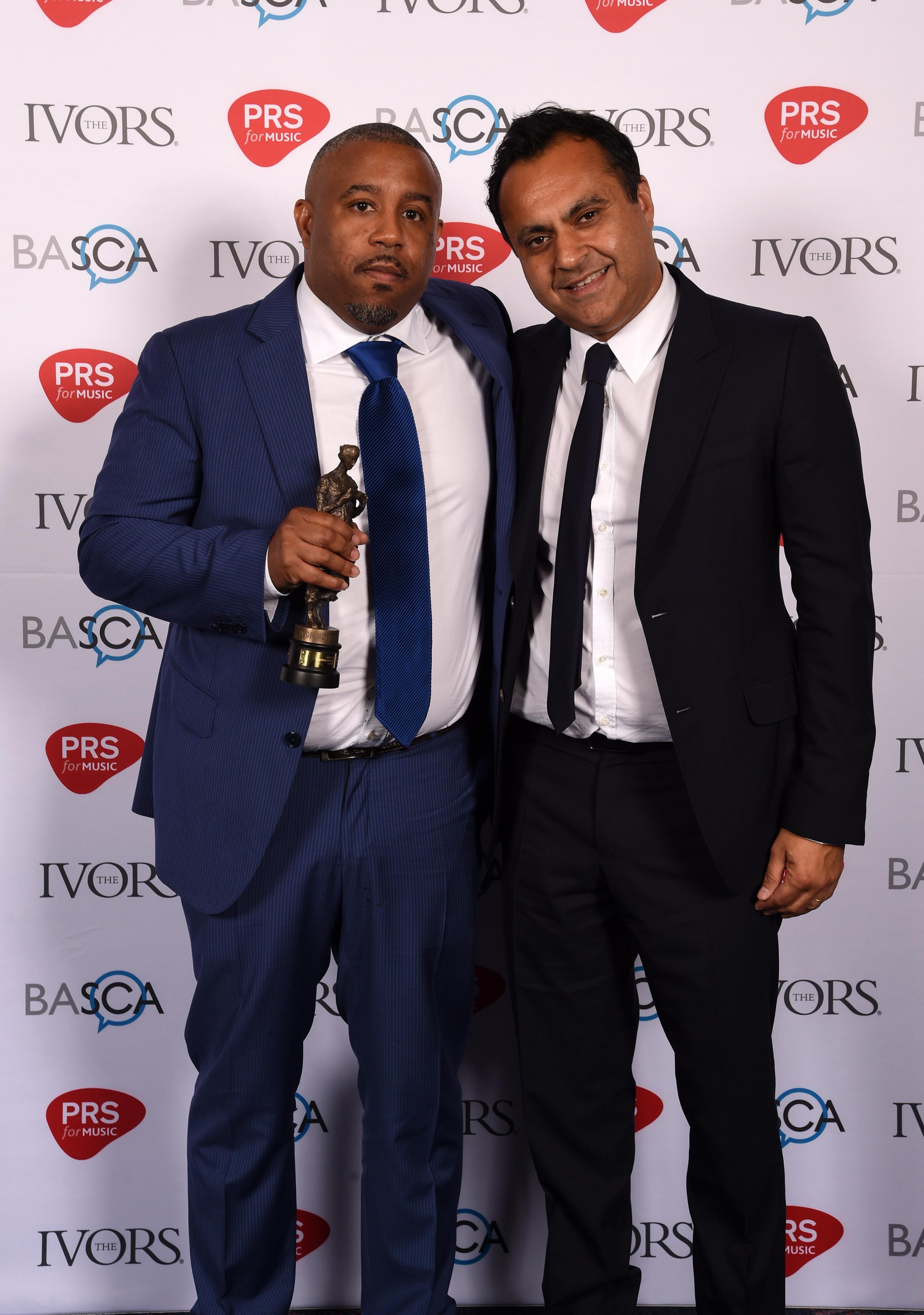 International Achievement - Wayne Hector and presenter Sonny Takhar - The Ivors 2016 photo Mark Allen